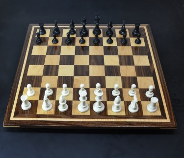 Walnut and Maple Chess Board with Curly Maple inlay frame image